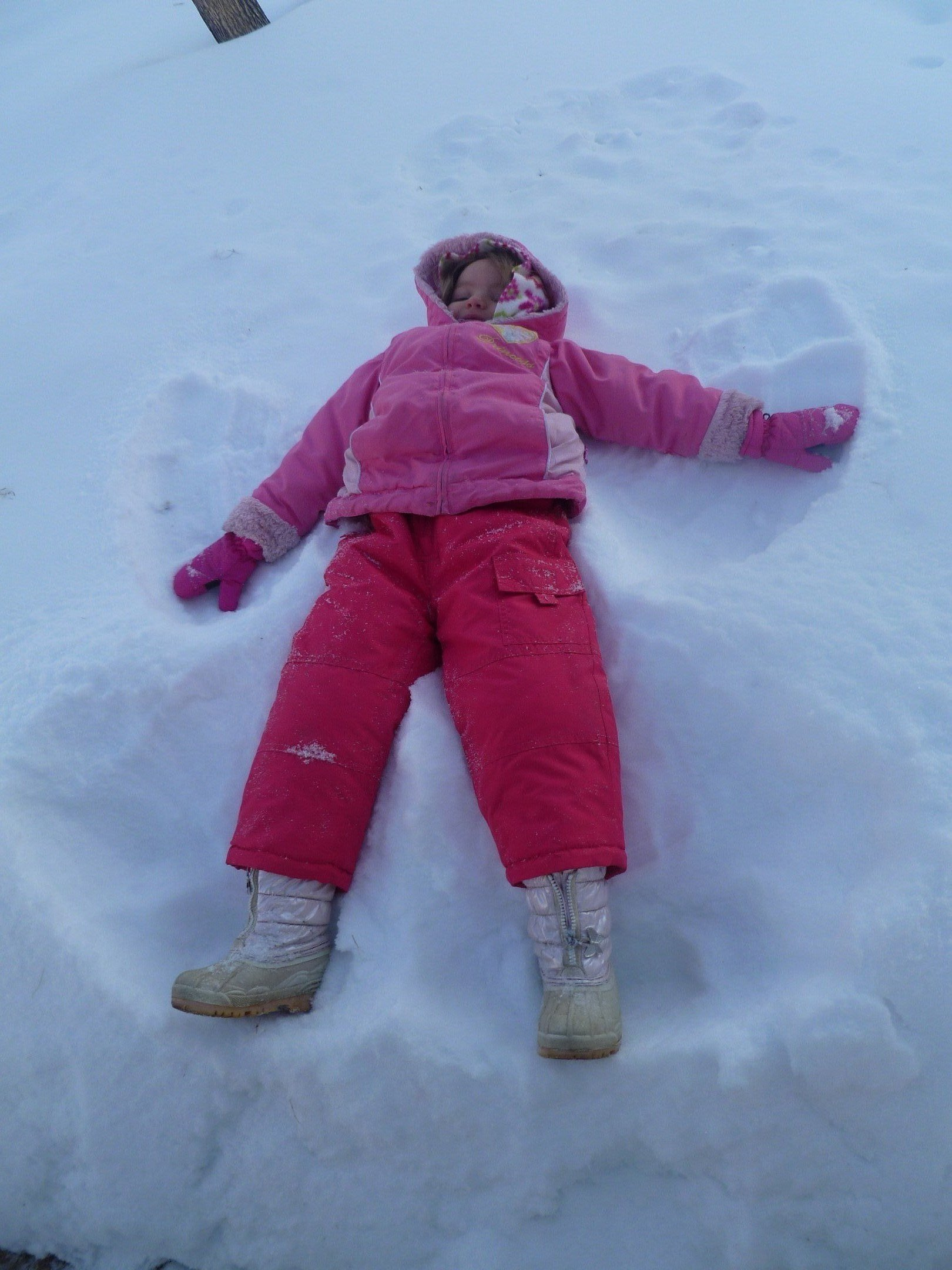 Allyssa making snow angels